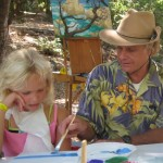 Peter Adams teaches painting techniques to a Pasadena-area youth from the Rose Bowl Aquatic Center Summer Camp during Plein Air Week at Kidspace Children's Museum.